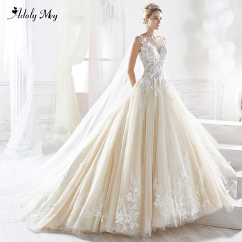Adoly Mey Charming Scoop Neck Button Tulle Court Train A-Line Wedding Dresses 2020 Luxury Beaded Appliques Princess Bride Gown