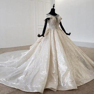 Image 3 - HTL1137 błyszcząca suknia ślubna nakryty rękawem o neck zasznurować gorset suknie ślubne wzburzyć pociąg ins gorąca sprzedaż świecący vestidos novia
