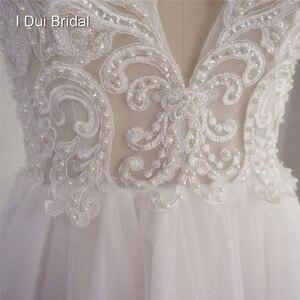 Image 5 - تغرق الرقبة الدانتيل فستان الزفاف خط الوهم الخلفي الاستقبال فستان زفاف 2020