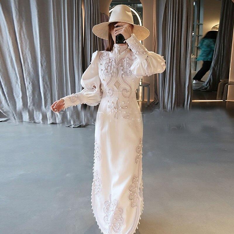 Goodlishowsi haut de gamme femmes fête robe de nuit solide évider broderie gland lanterne manches Sexy dos nu blanc robe mi-longue