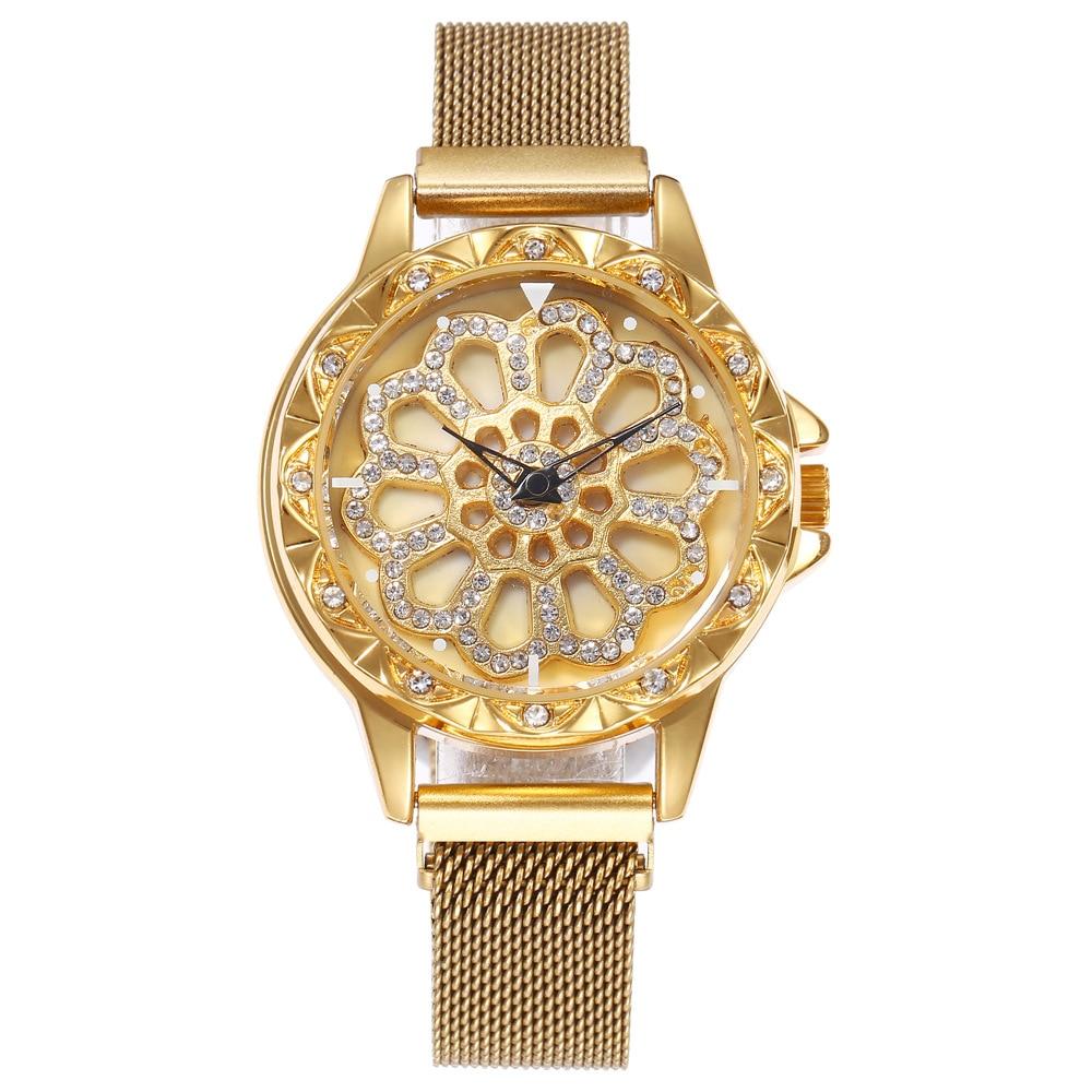 Montre à bracelet aimanté et à cadran tournant  or