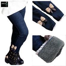 Новые брендовые штаны зимние меховые джинсы с бантом для девочек
