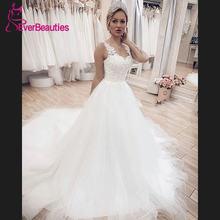 Элегантное свадебное платье трапеция с прозрачными лямками 2020