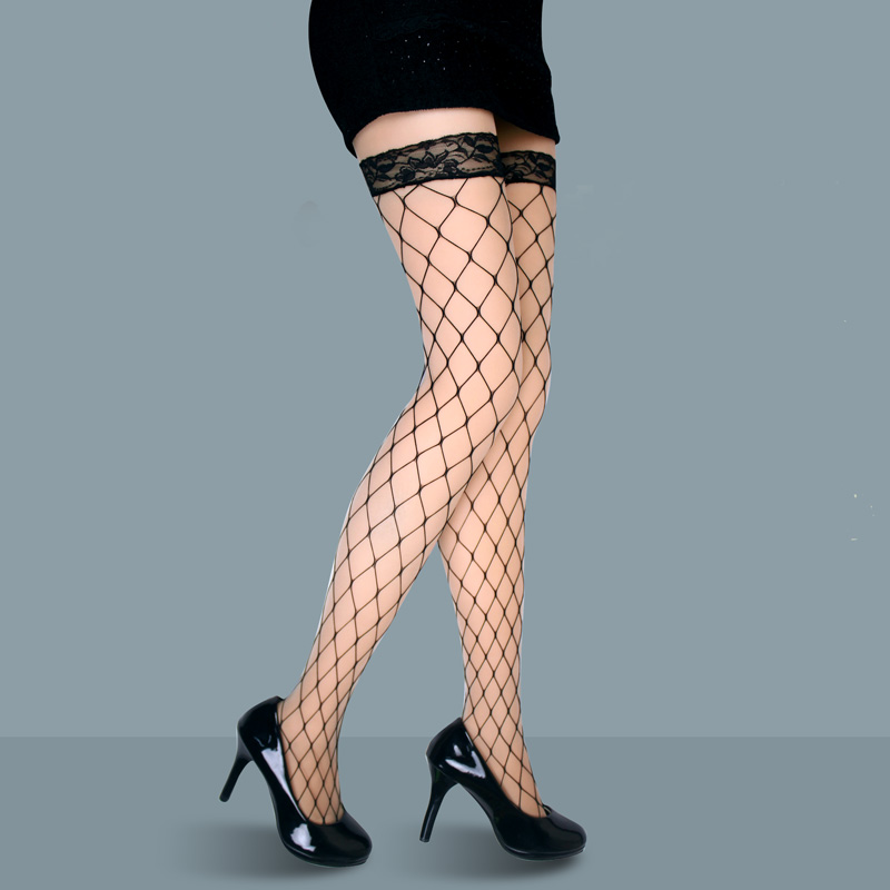 Women's neon pink thigh high fishnet stockings with bows