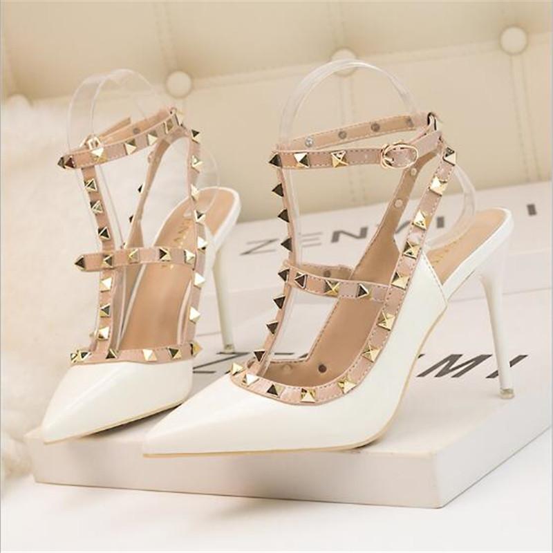 2020 New 10CM PUMPS woman Sexy nightclub stiletto heels patent leather metallic rivet hollow Roman fashion sandals