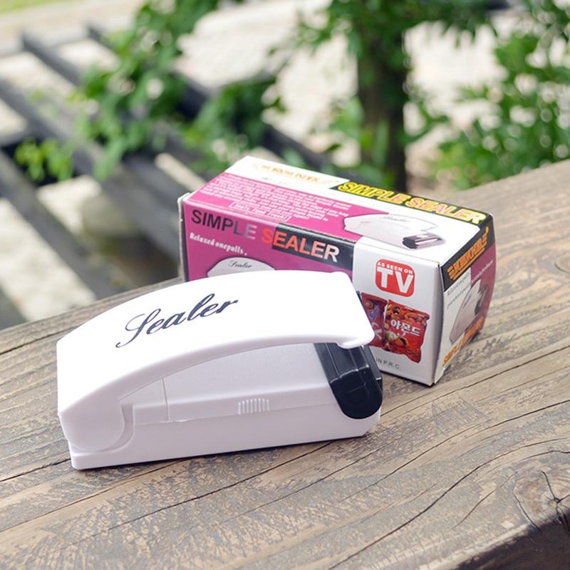 Lightweight  Mini Household Electric Hand Press  Food Sealer Plastic Packing Bag Hand Press Seal Machine Handy Sealing