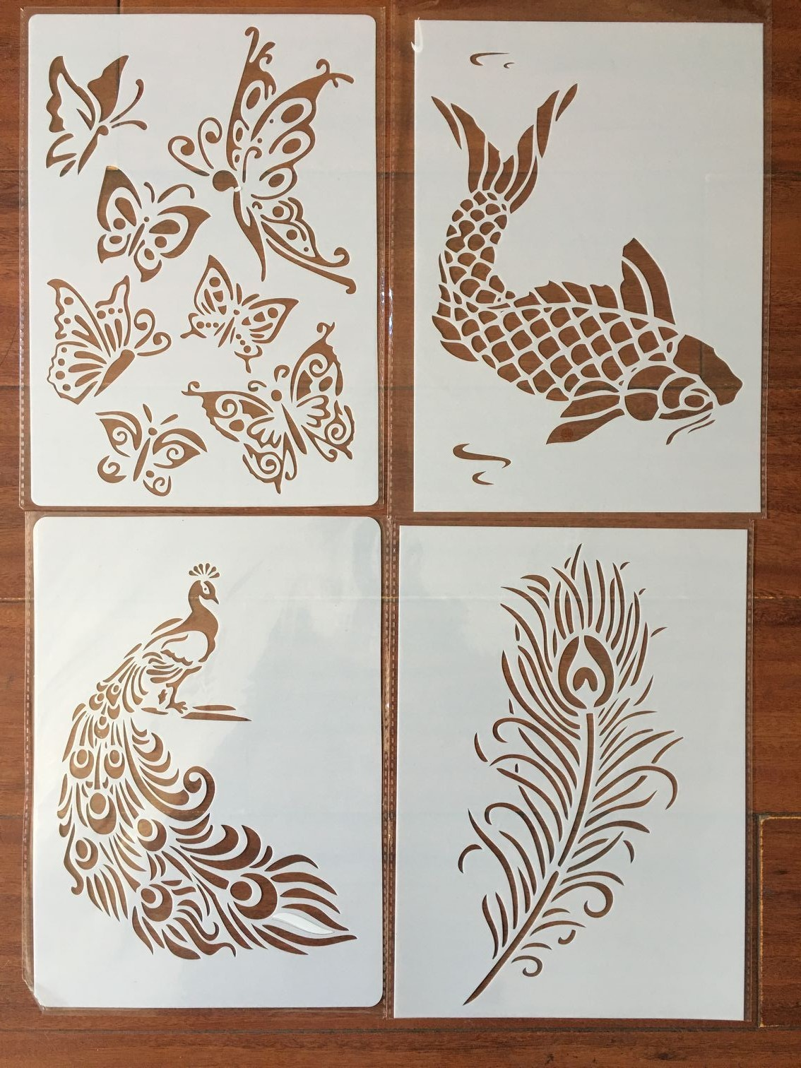 4pcs / Set A4 Peacock Feather Fish Butterfly Stencils Painting Coloring Embossing Scrapbook Album Decorative Template