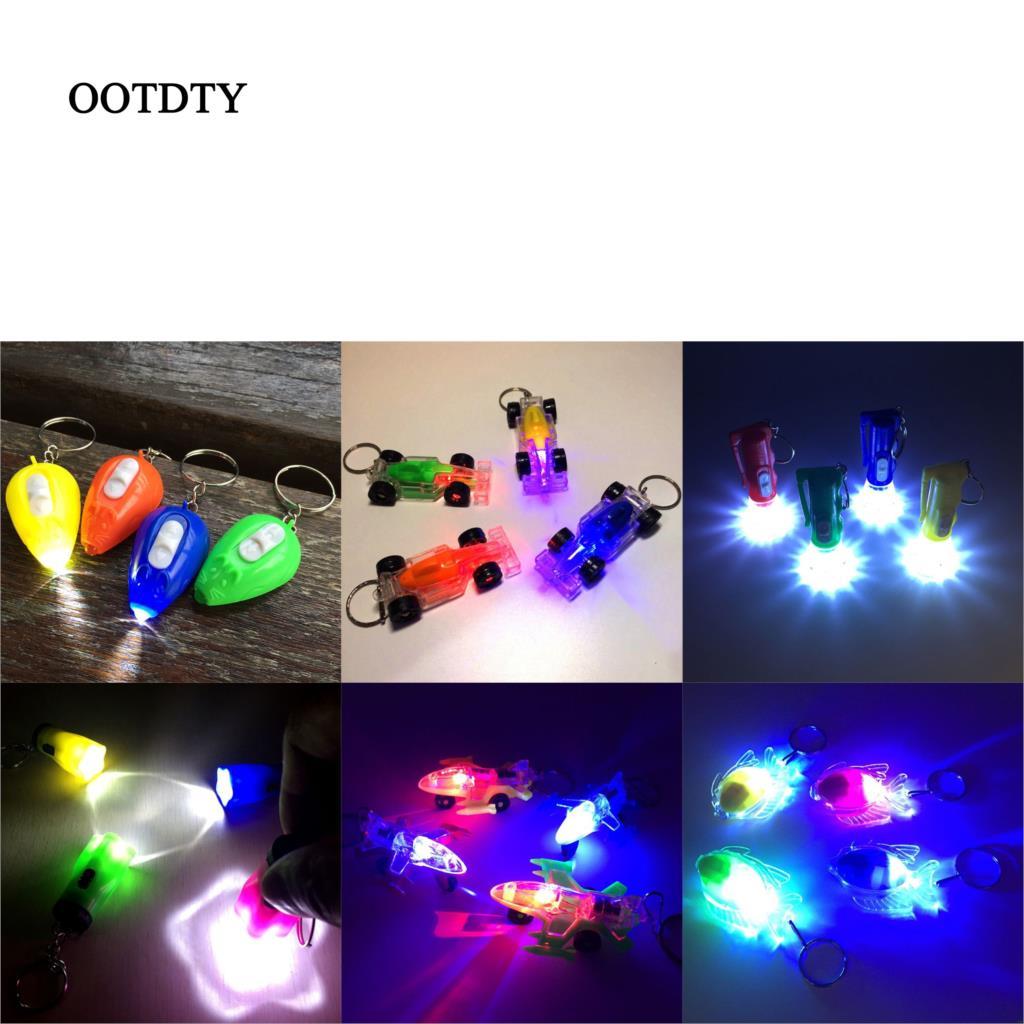 1PCS Mini LED Light-Up Toys Keychain Party Favor Kids Toy Gift Bag Pendant