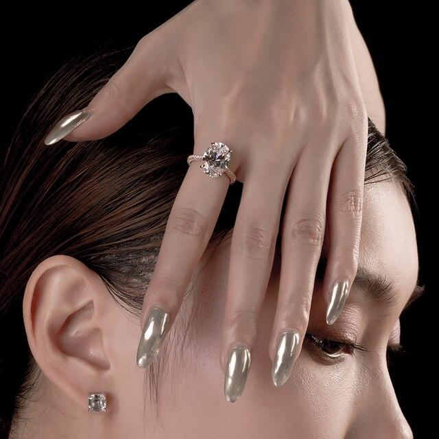 роскошное 5 карат овальное кольцо для помолвки женщин из стерлингового фотография
