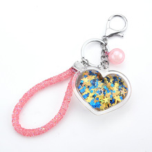 The new trend of the acrylic key chain love can flow sequins quicksand bag accessories car hang priced direct selling can can flow motion