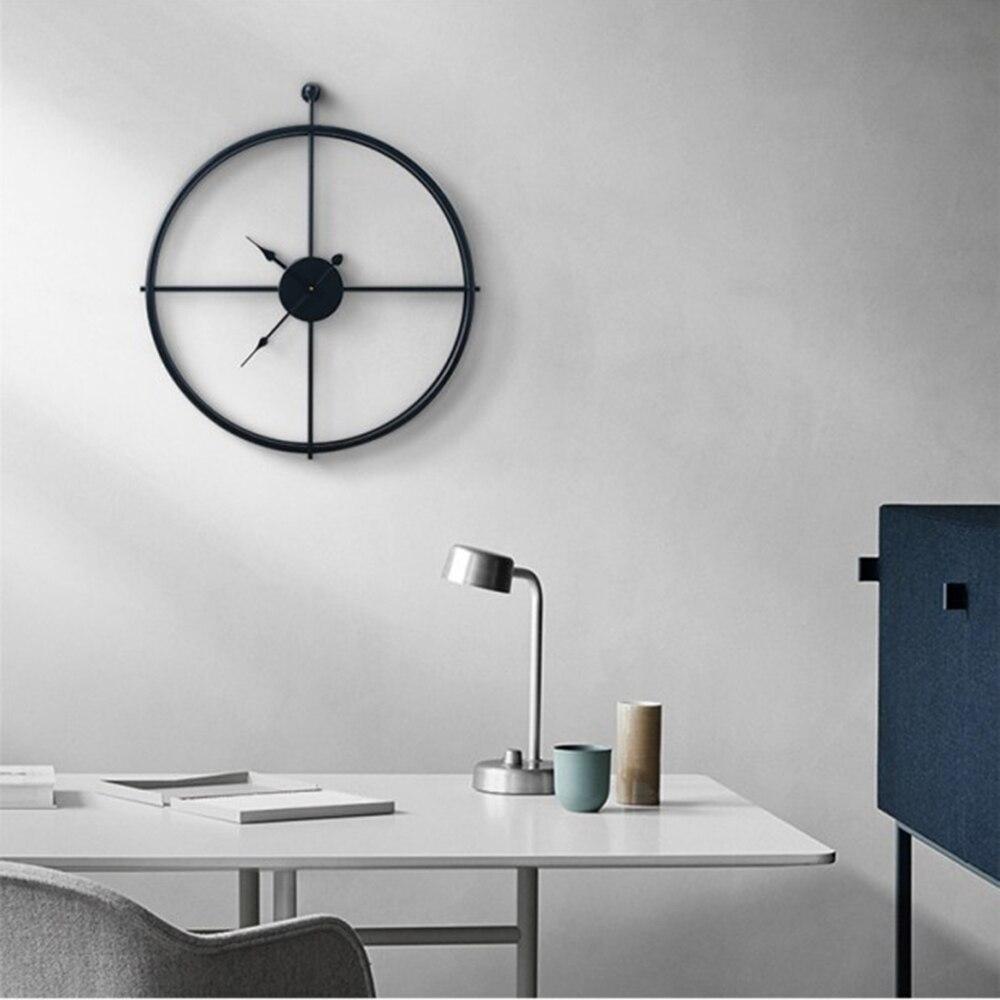 Nouvelle horloge murale créative Design moderne pour bureau à domicile décoratif suspendu salon classique brève montre murale en métal