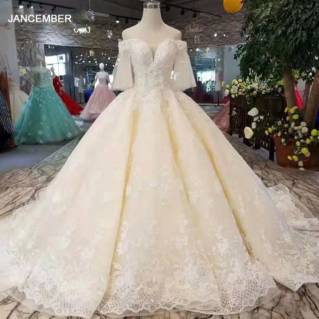 LS11087 light champagne wedding gowns flare half sleeves sweetheart lace up back ball gown from real factory formelle robes
