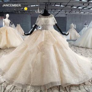 Image 1 - HTL1066 Peplum Bead Pearl Wedding Dresses Applique Lace Up Back Women Dress Wedding Glitter Свадебное Платье