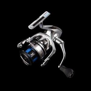Image 5 - SHIMANO STRADIC FL carrete giratorio de pesca, 1000HG/2500HG/C3000HG/C3000XG/4000XG/C5000XG 6 + 1BB HAGANE X PROTECT, carrete de pesca de agua salada