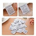 100 упаковок Новинка 1 г нетоксичный силикагель влагопоглотитель для комнаты кухни одежды пищевых продуктов пакеты для поглощения влаги