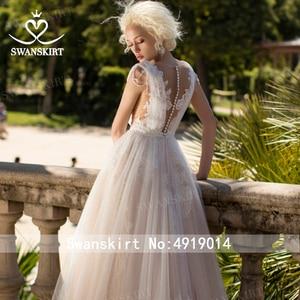 Image 5 - Fee V ausschnitt Perlen Hochzeit Kleid Strand Appliques Illusion Tüll A linie Ärmellose Swanskirt D121 Brautkleid Vestido de novia