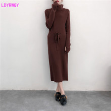 купить 2019 autumn and winter new Korean women's high collar long-sleeved loose tie solid color fashion wild bottom knit dress по цене 1486.29 рублей