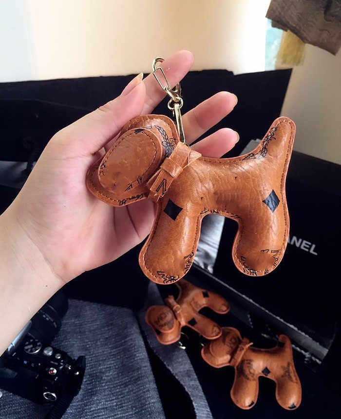 Super Nette Anhänger Keychain Männer Frauen Auto Schlüssel Kette Nette Schlüsselring Welpen Tasche Anhänger Großhandel Heißer Stil Leder Stimmung Tracker