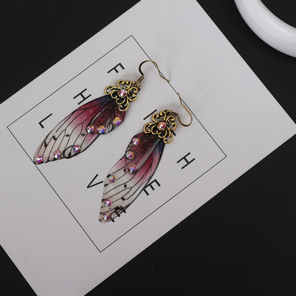 Купить с кэшбэком Fashion Handmade Femme Wing Drop Earrings Gold Color Fairy Tale Cicada Wings Earrings Rhinestone Purple Earrings Vintage Jewelry