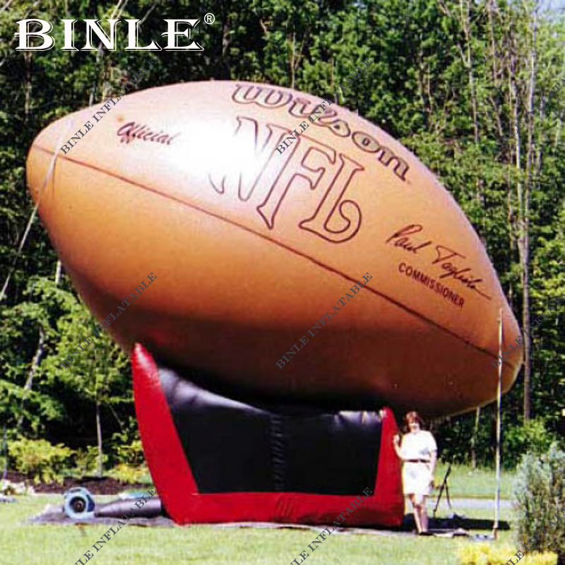Outdoor advertising 6mH giant NFL style inflatable football with Tee for sports event decoration