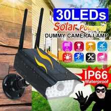 Lámpara Solar giratoria de 360 °, cámara de vigilancia de simulación, foco LED impermeable para exteriores, luz de pared con Sensor de movimiento para jardín y casa