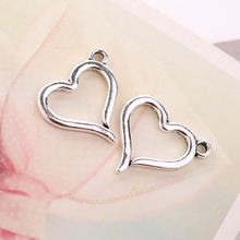 10 pieces / bag 20mm charm silver heart-shaped accessories DIY hollow pendants zinc alloy ancient jewelry a