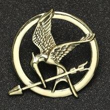 Broche de juegos del hambre para hombre y mujer, insignia con logotipo de flecha, pájaro, águila, Animal, película, moda Vintage, joyería, venta al por mayor