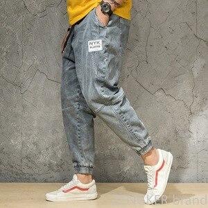 Image 2 - Wiosenny i jesienny kolor światła dżinsy męskie duże rozmiary luźne szarawary japońskie trendy spodnie do kostek spodnie wiązane 46