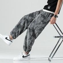 Moda masculina calças de camuflagem cintura elástica calças casuais para homem streetwear solto jogger pantalones