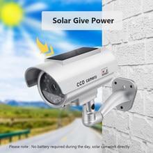 Caméra de surveillance factice, à panneau solaire, fausse CCTV étanche d'extérieur et d'intérieur avec moniteur lumineux LED