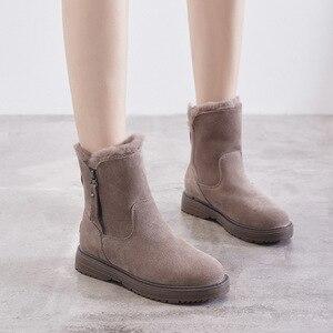 Image 1 - Chaussures dhiver en cuir véritable femmes bottes de neige chaussures chaudes hiver froid femme bottines femme hauteur augmentant 4.5cm YX1668