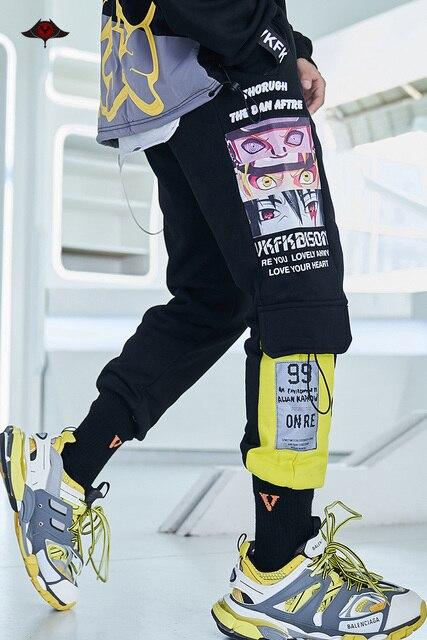 2020 Harajuku Naruto kombinezony Streetwear Anime spodnie joggersy Hip hopowe spodnie Cargo drukowane elastyczne odblaskowe spodnie dresowe
