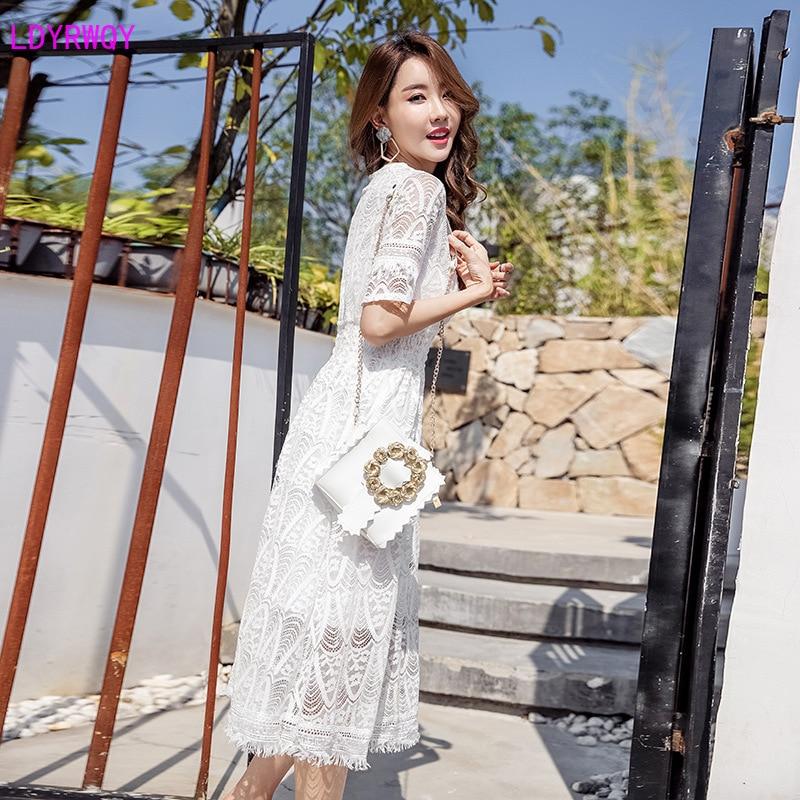 2019 summer new Korean version of the temperament slim Slim super fairy V-neck long section crocheted openwork lace dress