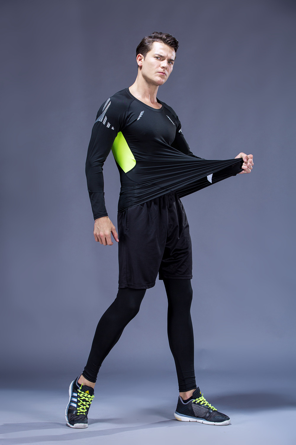Foto from the left on one men 5 pcs compressions clothes for gym. Men's 5 pcs compression tracksuit sports