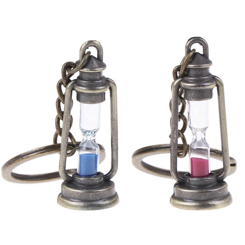 新 1Pc かわいい金属ランプ形状タイマー砂時計キーチェーンリングカップルのキーチェーンギフト