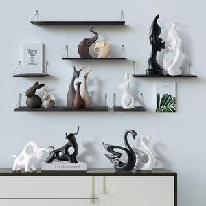 Image 3 - Nordic Table ceramiczne ozdoby porcelanowe zwierzęta dekoracje obejmują słoń kot jeleń królik ślimak wyroby do dekoracji domu miniatury