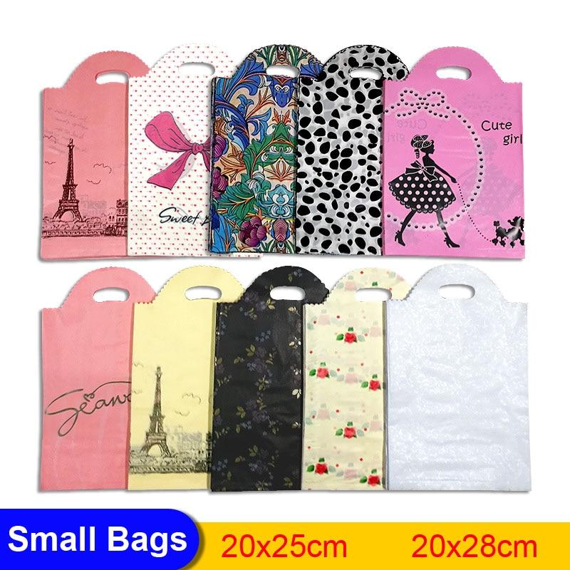 50 pces mais padrão jóias pequeno saco de plástico 20*25cm/20*28cm laço com alça loja presente embalagem sacos de plástico alça