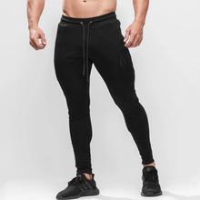 Czarne obcisłe spodnie do biegania męskie spodnie do biegania sportowe spodnie do biegania siłownia treningowe spodnie do ćwiczenia męskie Jogging Sportswear tanie tanio GLOBESKY Sznurek COTTON Poliester Pasuje prawda na wymiar weź swój normalny rozmiar Pełnej długości Men Sweatpants