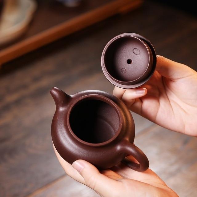 Zhijun, un célèbre expert Yixing, un pot de Zisha, un pot de Zisha fait à la main, du minerai brut, de la boue pourpre Benshan et un service à thé kungfu