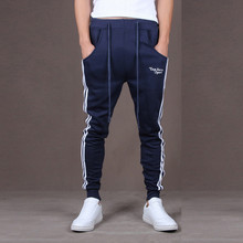 Men's solid color stitching training sports trousers top her