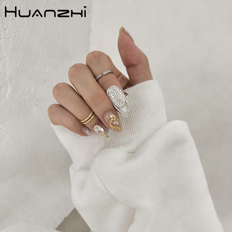 HUANZHI-2020-New-Korean-Trendy-Cool-Shiny-Rhinestone-Inlaid-Fingertip-Nail-Alloy-rings-for-Women-Girls (1)