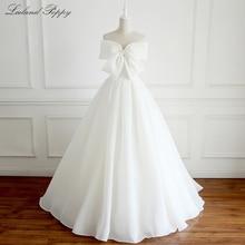 Lceland Poppy Elegant A line Organza Wedding Dresses 2020 Floor Length Sleeveless Vestido de Novia Bridal Gowns with Bow Knot