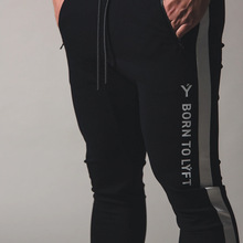 2020 new color matching sports stretch trousers men's sports fitness casual pants trousers zipper stitching foot pants