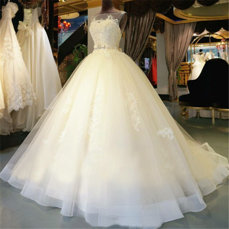 Beautiful Ball Gown Sleeveless Tulle Wedding Dresses Illusion Neckline Appliques Elegnat Bridal Gowns Custom Made Court Train