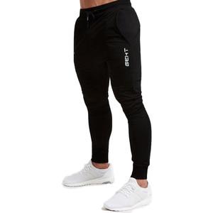 Image 4 - ブランドメンズスポーツランニングパンツ通気性ジョギングパンツスポーツパンツを実行するためのテニスサッカー再生ジムズボンポケット