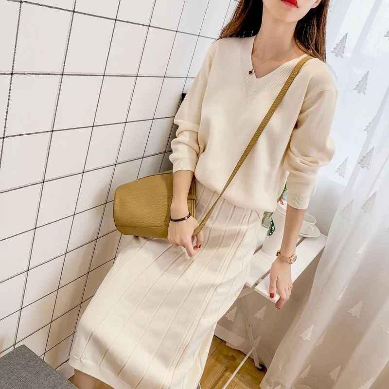 Mujer suéter falda de dos piezas mujer 2019 Otoño e Invierno nueva moda Coreana de punto suéter y falda caliente de cuello en v