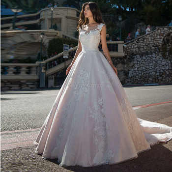 Light Pink Wedding Dresses 2019 Lace Appliques Sleeveless Bridal Gowns A-Line Illusion Court Train Vestido De Noiva Plus Size
