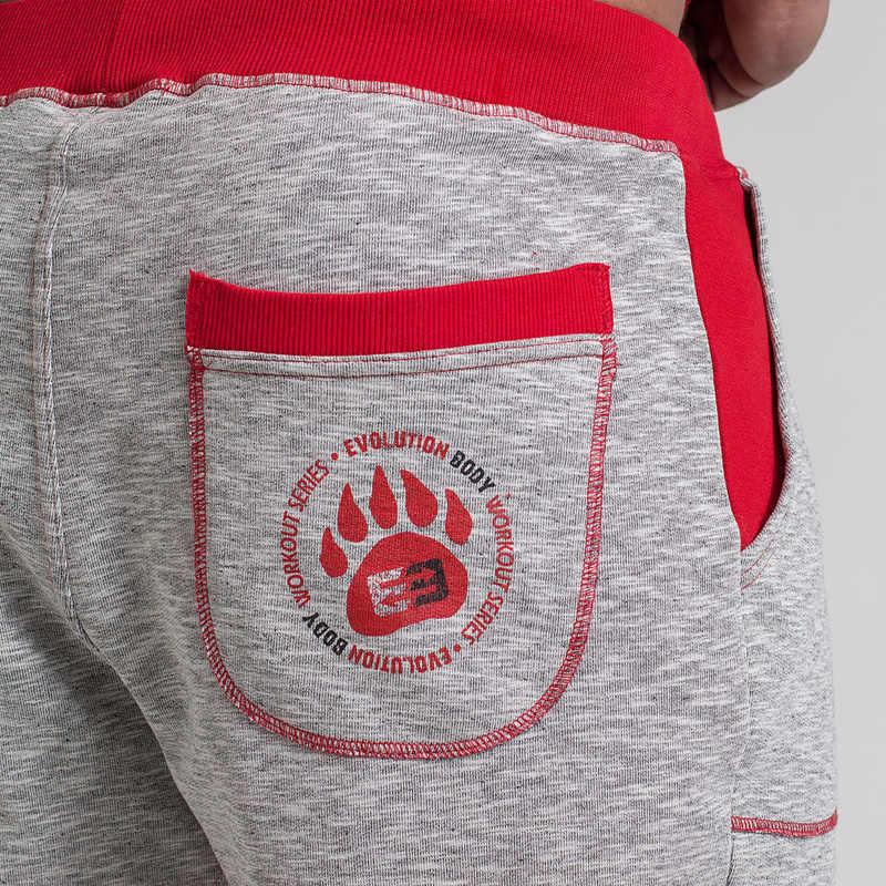 رجل رياضة القطن السراويل تشغيل الركض في الهواء الطلق الرياضة اقتصاص اللياقة البدنية Sweatpants الذكور تجريب نجوم النادي الأهلي الملابس سراويل قصيرة