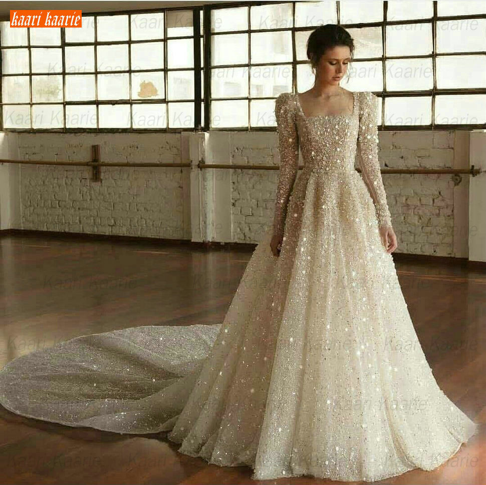 Luxury African Wedding Gowns Long Sleeve White Tulle Beaded Crystal Sparkly Bridal Dresses Custom Made Royal Train Wedding Dress