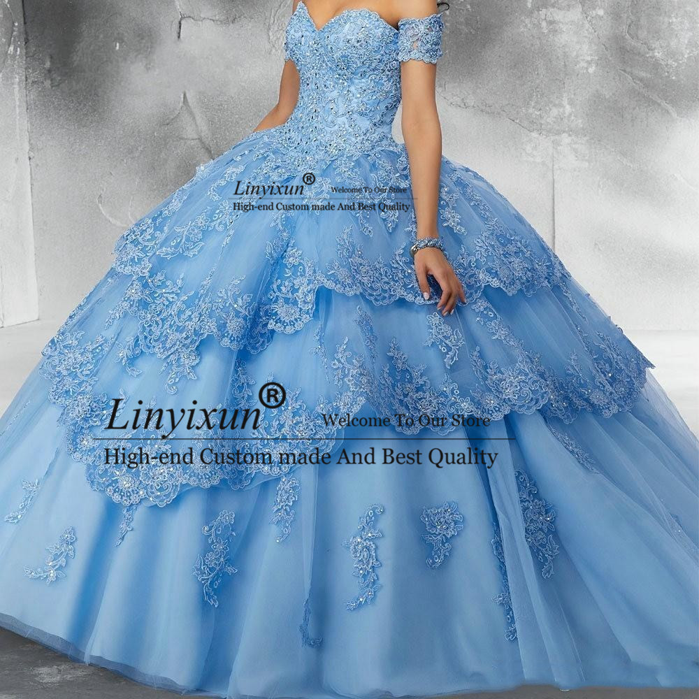 Lumière bleu ciel modeste dentelle robe de bal Quinceanera robes paillettes Applique Tulle hors de l'épaule formelle fête douce 16 robe